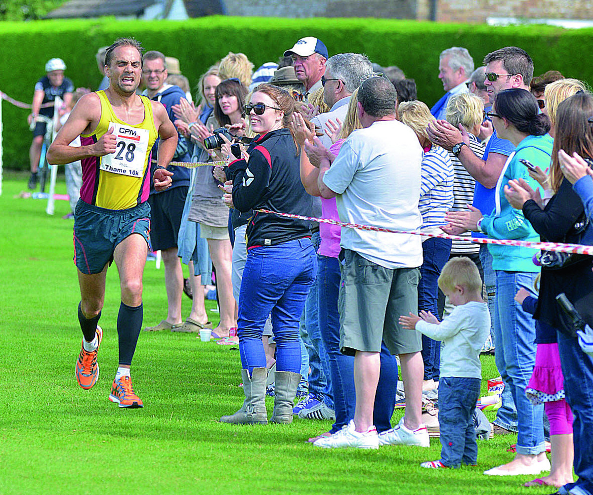 Cheered on by the crowds as he comes in second at the Thame 10k yesterday is Paul Fernandez running, for Abingdon AFC