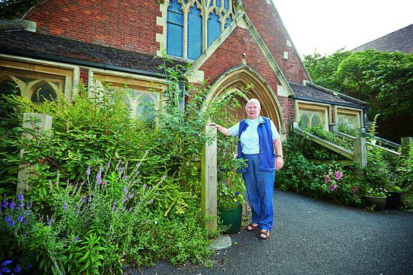 The Oxford Times: Pauline Main, Minister at Summertown United Reformed Church, pictured next to the wooden beams that are currently supporting the building