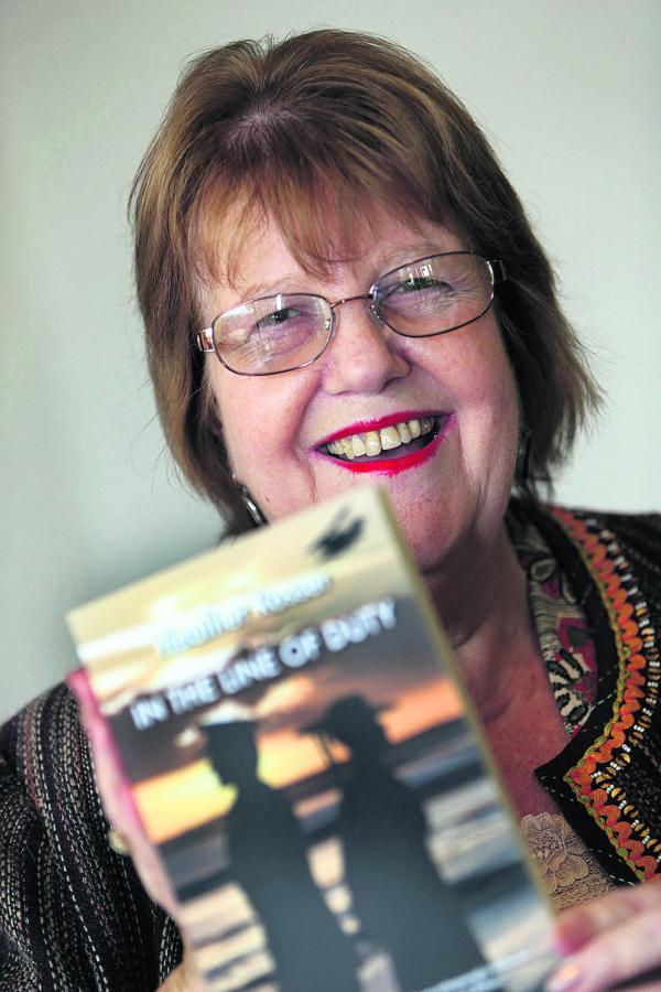Heather Rosser, from Botley, with the book she wrote inspired by her grandfather's wartime role