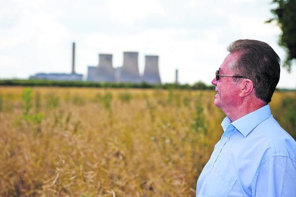 Neighbour Michael Jenkins looks towards Didcot Power Station