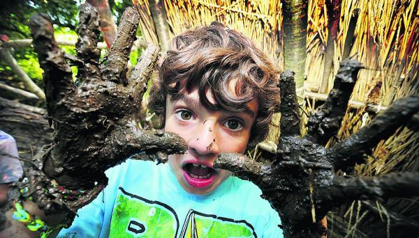 Luke Shirley, aged seven, gets his hands mucky daubing mud at the Hill End Centre. Picture: OX68288 Damian Halliwell