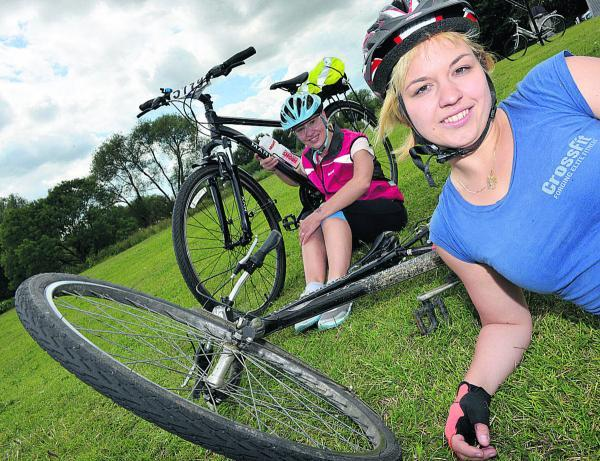 The Oxford Times: Aneta Brzakova and Helena Deakih rode out from Oxpens Meadow. Picture: OX68101 Simon Williams