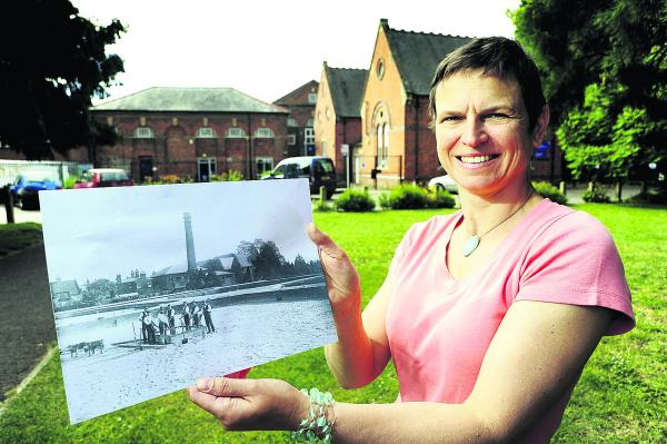 Oxford historian Liz Woolley with a photo showing the old waterworks buildings, with the now South Oxford Community Centre behind her. Picture: OX68386 David Fleming