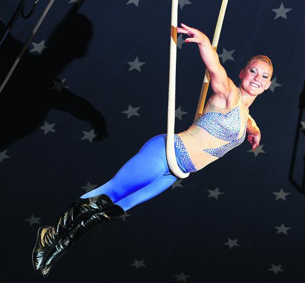 Trapeze artist Zsufia Jakab on the aerial cloud swing