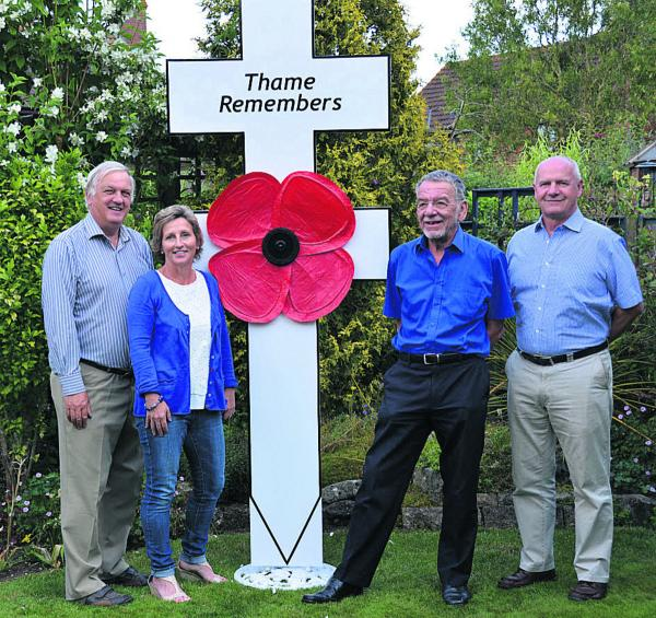 The steering group for Thame Remembers, from left, David Bretherton, Patsy Baker, Mike Dyer and Ian Jones with one of the crosses to honour the town's Fallen