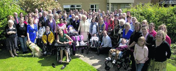 Tom Hill, inset, with staff and patients of Helen & Douglas House during the visit of the Duchess of Cornwall