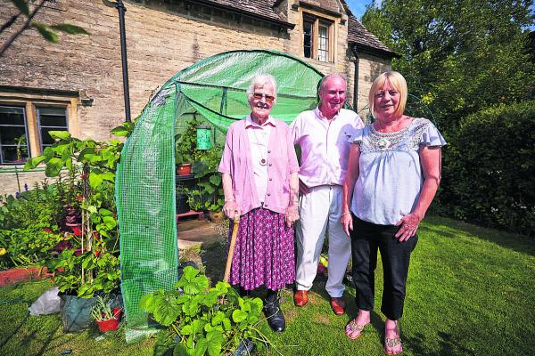 Paul Humphreys, from Kidlington Voice, with almshouses residents Lily Smith, left, and Jeane Mason, right
