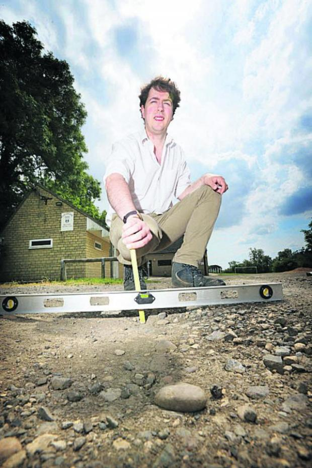 The Oxford Times: Cllr Luke Caunt in the car park at Leafield Village Hall Picture: OX68601 Damian Halliwell
