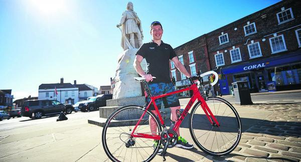The Oxford Times: Gareth Hudson, who works at Ridgeway Cycles, in Wantage Market Square with a £3,000 carbon fibre Trek road bike. He is looking forward to the Tour of Britain