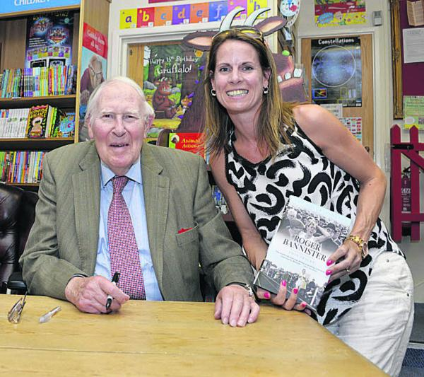 Sarah Rendell, of Alchester Running Club, with Sir Roger Bannister