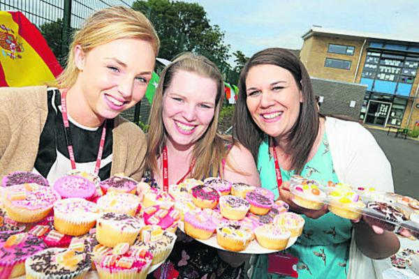 Primary school staff, left to right, Georgina O'Connell, Sarah Fellows and Kirsty Morgan running the cake stall.  Picture: OX68549 Damian Halliwell