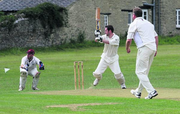 Combe's Mike Eeley hits a four in their 37-run win at hom