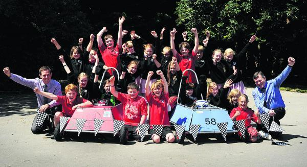 The Oxford Times: A team of children from The Hendreds Primary School took on more than 70 teams from around the country racing their electric cars at Goodwood. The group are pictured with teachers Jamie Veness, left, and Chris Savage