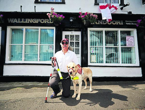 Mike Leader with his guide dog Tudor pictured outside the Wallingford Tandoori                  Picture: OX68602 Cliff Hide