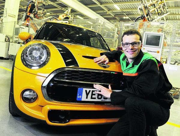Tom Bradford, Mini body shop production manager with the award-winning model. Picture: OX68654 Mark Hemsworth