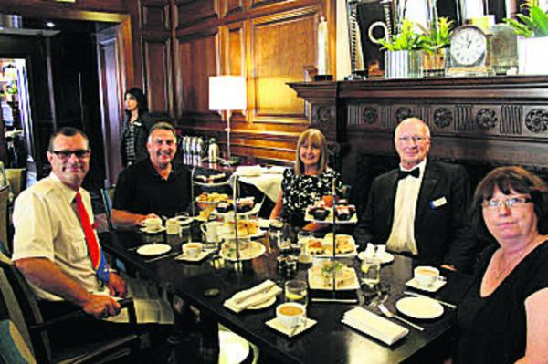 From left, Russell Bridges, Chris Young, Marcella Young, Jarvis West and Alicia Phillips enjoy afternoon tea at The Grosvenor Hotel after winning the treat as part of the launch of the new Oxford Tube coaches
