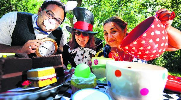 Minal Patel as the White Rabbit, Barbara Griffiths as the Mad Hatter and Netti Viegas as the Red Queen