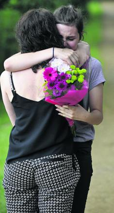 Tears and hugs: Anne-Marie Cockburn comforts Maisy Summers, a former schoolfriend of Martha Fernback, at Hinksey Park as she arrives to lay flowers a year after Martha's death during the picnic held in her memory