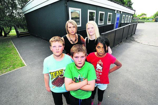 LESSONS: Larkrise Primary School teachers, Steph Capon, left, and Fiona Clark with pupils, from left, Josh Mattinson, Maryam Hamid and Kai Mattinson, all, 10