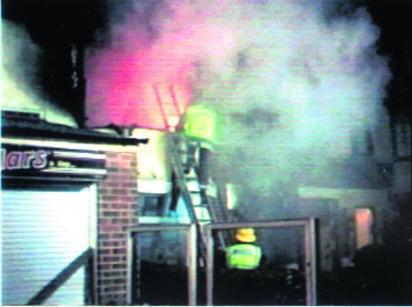 Fire crews tackle the blaze in Magdalen Road on August 26, 1997