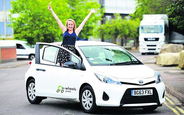 Ellie Grebenik with a Co-Wheels hybrid car