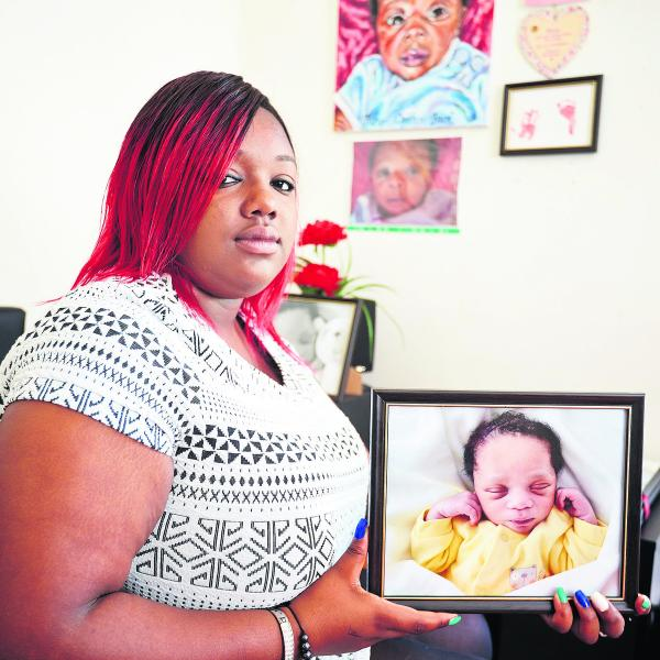 Tessa Jack, pictured in her bedroom with a photograph of her son, Takai, who died when he was six weeks old.  Picture: OX68791 Cliff Hide