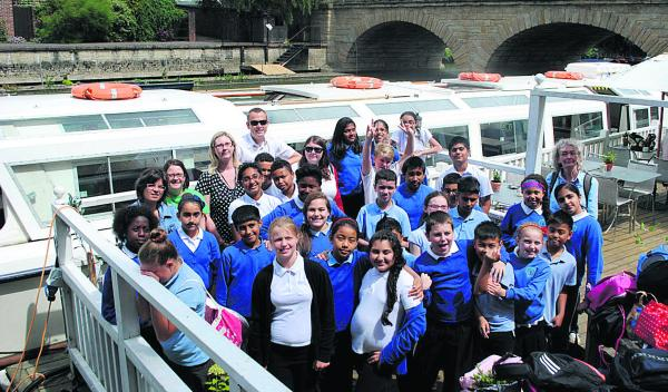New Marston Primary School pupils in their floating classroom during an educational trip on the Thames