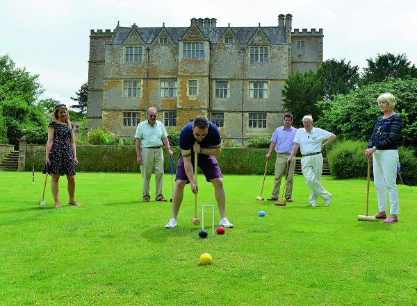 Andy Jones plays croquet at Chastleton House near Chipping Norton