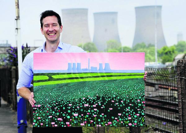 Patrick Cannon with one of his power station paintings