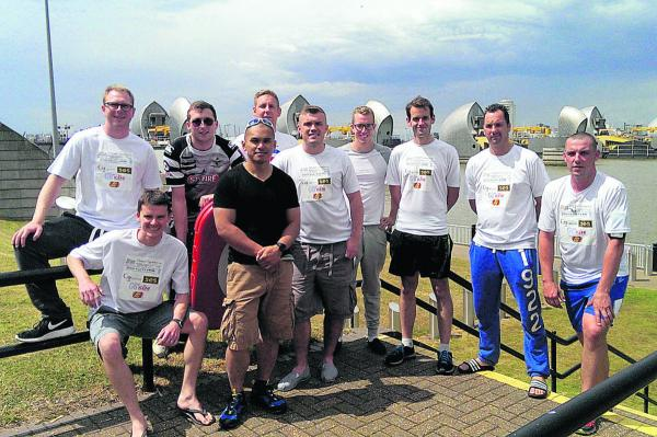 Journey's end at the Thames Barrier: Back, SAC Liam Allen, SAC Lee Cunnick, Cpl Dom Frapwell, SAC Chris Turner, A/Sgt Stu Goodhall, Sgt Andy Kuchta, Cpl Scott Butchart; front, Sgt Jim Weeks, SAC John Lewis, Cpl Alex Leathley