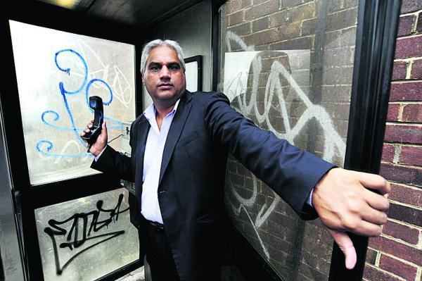 Altaf Khan in an abandoned BT phone box on Kennett Road
