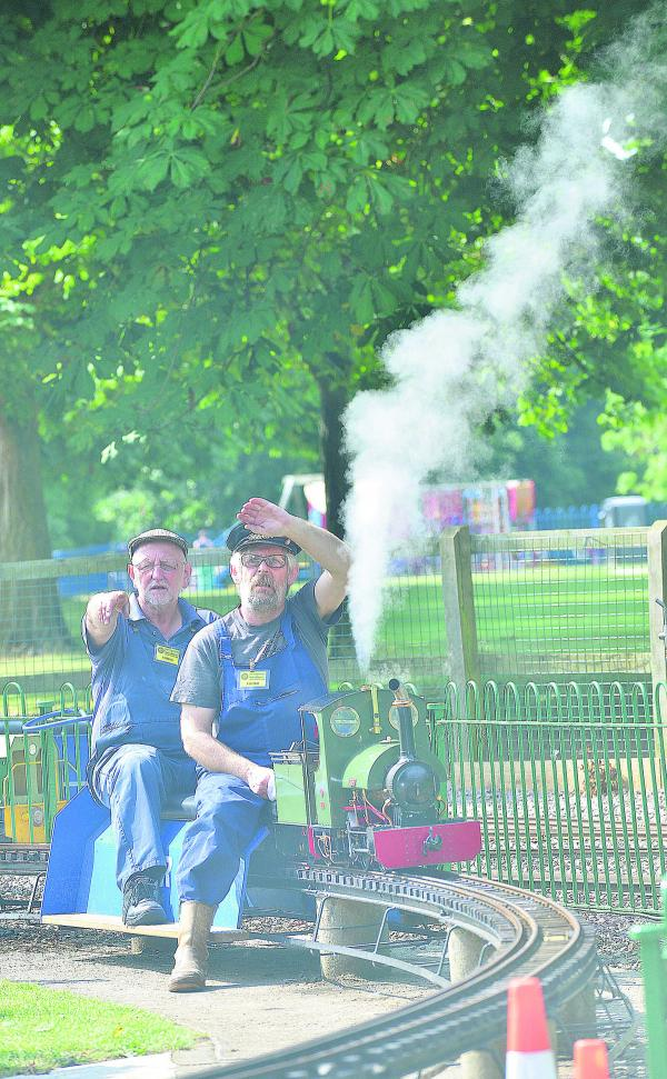 STEAM'S UP: Getting steam up on their Freelance Quarry loco, called Irene, at Saturday's event in Cutteslowe Park are John Roulstone, front, and Derek Graig