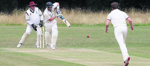 Thame Town's James Crichton clips the ball off his legs for two during his innings of  33