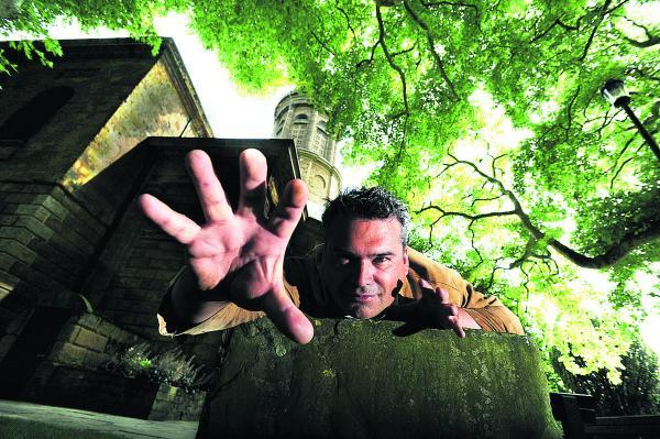 Join in: Tony Jopia pictured in St Mary's churchyard in Banbury where he plans to start filming his zombie movie Apocalypse using hundreds of local residents as extras