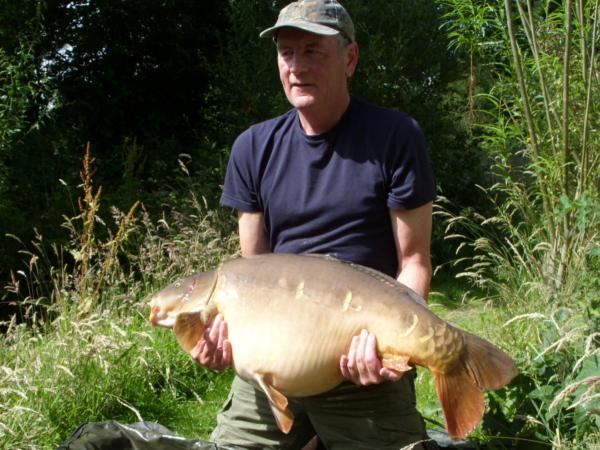 Paul Claridge with one of his carp