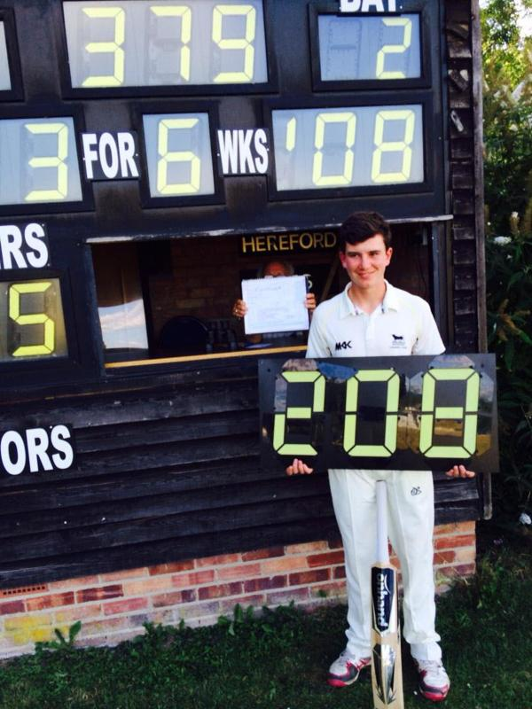 Jordan Garrett marks his double hundred in front of the scoreboard