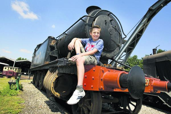 Josh Granger, nine, takes time out on an engine
