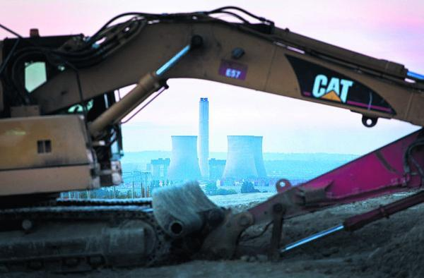 A digger lays in wait for the cooling towers' demolotion