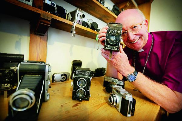 Bishop of Oxford John Pritchard with his collection of classic cameras