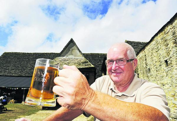 CHEERS: John Binley raises a glass to the festival
