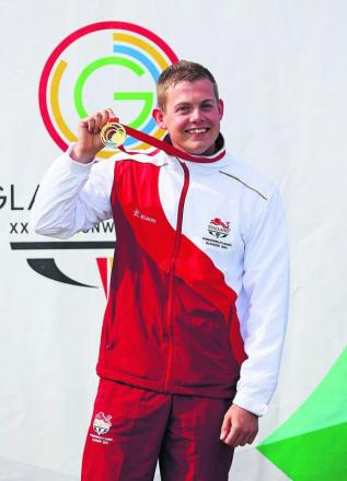 Dan Rivers with his gold medal