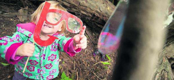 Seren Shepherd-Loxton, 22 months, looks for marine life (here a turtle) through a mask and snorkel. Picture: OX68945 Andrew Walmsley
