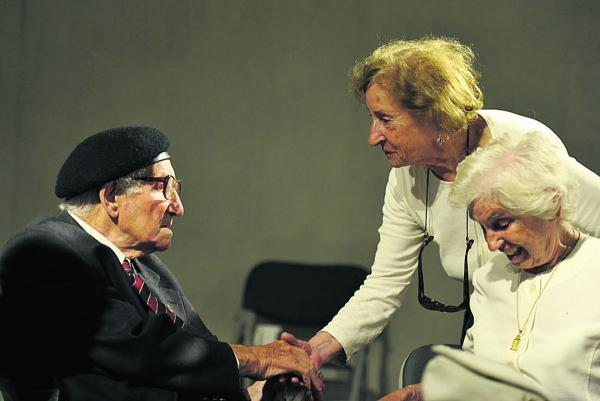 Gilbert King shakes hands with Holocaust survivor Susan Pollack, while fellow survivor Renee Salt looks on. Pictures: OX69138 Mark Hemsworth