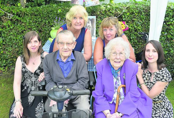 Fred and Winnie with, from left, granddaughter Corinna Board, daughter Alison Woodward, daughter Janice Borondo, and granddaughter Victoria Borondo