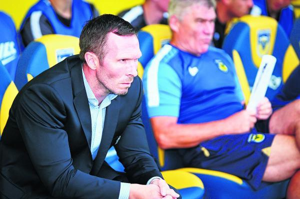Oxford United head coach Michael Appleton takes his seat in the dug-out alongside assistant Derek Fazackerley before Saturday's 1-0 defeat against Burton on the opening day of the Sky Bet League Two season
