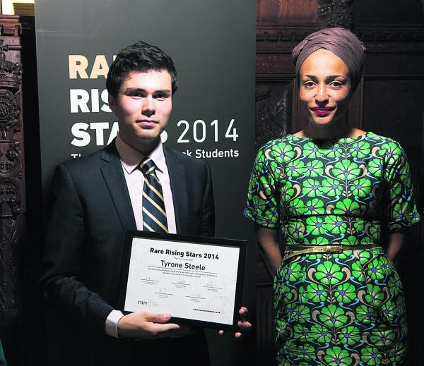 Tyrone Steele with author Zadie Smith at the House of Commons with his Rare Rising Star award