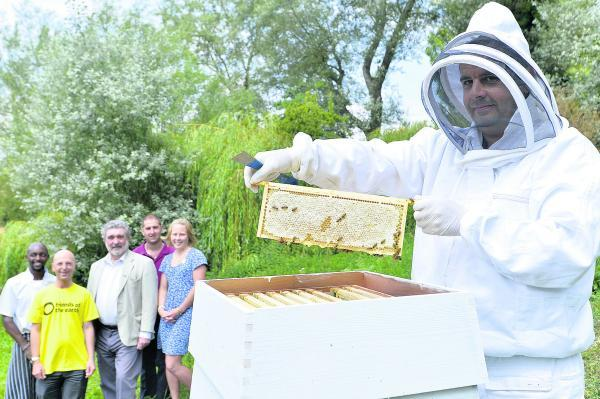 Pictured, from left, at a beehive at The Old Swan and Minster Mill hotel are head chef David Mwiti; Tim Beckman, of Friends of the Earth; Cllr David Willi