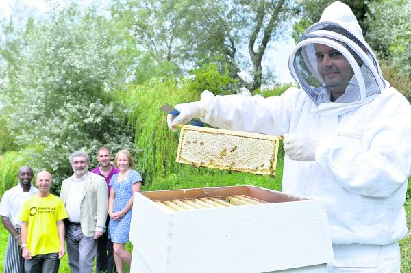 Pictured, from left, at a beehive at The Old Swan and Minster Mill hotel are head chef David Mwiti; Tim Beckman, of Friends of the Earth; Cllr David Williams; Paul Steele, assistant gardener; and Clare Norrish, sales and marketing executive. Front: Beekee