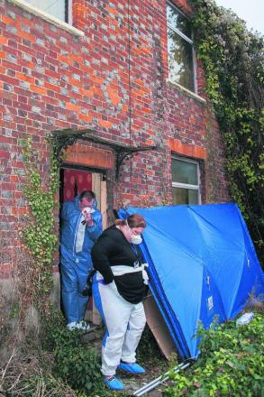 Police forensic investigators at the house in Cowley Road, Littlemore, last year