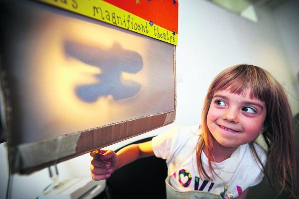 Rose Sheppard, seven, checks out her shadow puppet at the Cornerstone Arts Centre